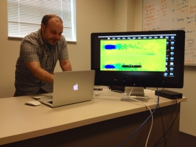 Josh Levine shows how GPUs work in his McAdams Hall office at Clemson University.