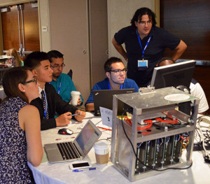 XSEDE Scholar Paul Delgado, top right, works with his team at the XSEDE13 conference computer modeling competition in San Diego in July of 2013. Image credit: XSEDE Scholar's Program.