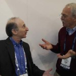 Dr. Saul Perlmutter (left) holds an animated conservation with John Kirkley at SC13. Photo by Sharan Kalwani, Fermilab